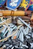 Bandeja com armas do brinquedo em uma feira de produtos medievais Fotografia de Stock