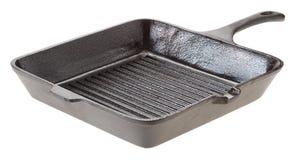 Bandeja da grade do frigideira do ferro fundido Isolado no branco Imagem de Stock