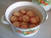 Bandeja das batatas Imagens de Stock