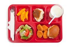 Bandeja del almuerzo de escuela en un fondo blanco Fotografía de archivo libre de regalías