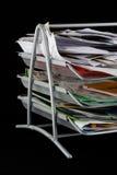 Bandeja del papel sucia con los papeles Fotografía de archivo libre de regalías