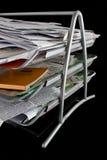 Bandeja del papel sucia con los papeles Fotografía de archivo