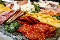 Bandeja del partido de la carne y del queso Foto de archivo