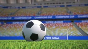 Bandeja do close-up em torno de um futebol na grama em um estádio vazio ilustração royalty free