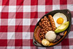 Bandeja paisa, typical dish at the Antioqueña region of Colombia. It consists of chicharrón fried pork belly, black pudding, royalty free stock photo