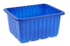 Bandeja plástica azul en un fondo blanco imagen de archivo libre de regalías