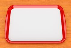 Bandeja plástica roja de la comida con el trazador de líneas vacío Fotografía de archivo libre de regalías