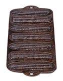 Bandeja temperado, velha da vara do milho do ferro fundido isolada no vertica branco Fotografia de Stock Royalty Free