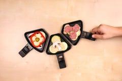 Bandejas de Raclette Foto de Stock Royalty Free