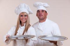 Bandejas em branco dos cozinheiros chefe Imagens de Stock