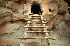 Bandelier National Monument. Kiva ladder leading up to an ancestoral cliff dwelling at Bandelier National Monument Stock Images