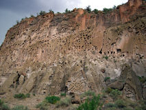 Bandelier Ruins Cliff. Photo of porous sandstone cliff at Bandelier Ruins National park in New Mexico.  These cliffs were home to early civilizations due to the Stock Photos