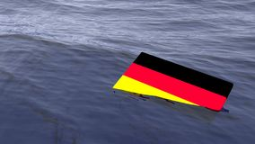 Bandera alemana que se ahoga en el concepto de la crisis de Alemania del océano Fotos de archivo