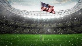 Bandera americana con nieve que cae en vídeo del estadio