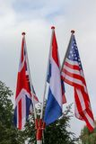 Bandera americana, bandera inglesa y bandera de los Países Bajos imagen de archivo libre de regalías