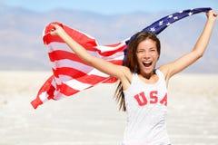 Bandera americana - la mujer los E.E.U.U. se divierte al ganador del atleta Imagenes de archivo