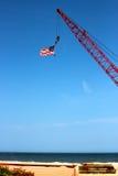 Bandera americana sobre el océano Fotos de archivo