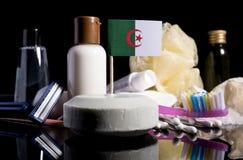 Bandera argelina en el jabón con todos los productos para la gente Foto de archivo