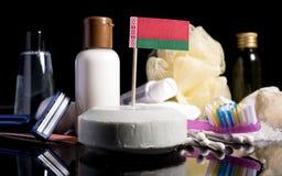 Bandera Belorussian en el jabón con todos los productos para la gente Imagen de archivo libre de regalías