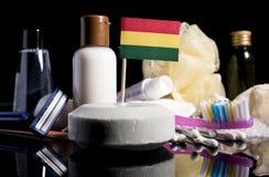 Bandera boliviana en el jabón con todos los productos para la gente Imagen de archivo libre de regalías