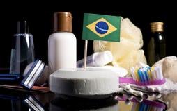 Bandera brasileña en el jabón con todos los productos para la gente Fotografía de archivo libre de regalías