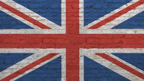 Bandera británica BRITÁNICA del viejo vintage sobre la pared de ladrillo foto de archivo