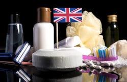 Bandera BRITÁNICA en el jabón con todos los productos para la gente Foto de archivo libre de regalías