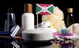 Bandera burundesa en el jabón con todos los productos para la gente Fotografía de archivo libre de regalías