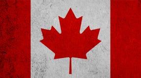 Bandera canadiense en el fondo de papel Fotografía de archivo libre de regalías