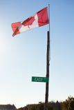 Bandera canadiense en posts que soplan en el viento Imágenes de archivo libres de regalías