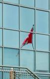 Bandera canadiense en vidrio azul Foto de archivo libre de regalías