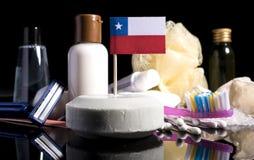 Bandera chilena en el jabón con todos los productos para la gente Foto de archivo libre de regalías