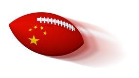 Bandera china en bola de rugbi con la falta de definición de movimiento en blanco Foto de archivo
