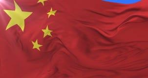 Bandera china que agita en el viento con el cielo azul, lazo