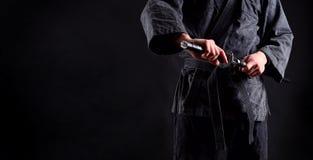 Bandera con el ninja, samurai foto de archivo libre de regalías