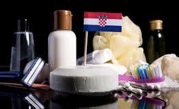 Bandera croata en el jabón con todos los productos para la gente Foto de archivo libre de regalías