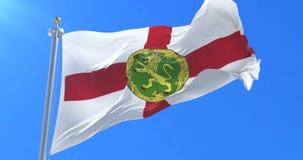 Bandera de Alderney que agita en el viento con el cielo azul, lazo ilustración del vector