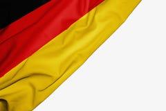 Bandera de Alemania de la tela con el copyspace para su texto en el fondo blanco ilustración del vector