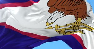 Bandera de American Samoa que agita en el viento en lento, lazo
