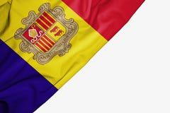 Bandera de Andorra de la tela con el copyspace para su texto en el fondo blanco stock de ilustración