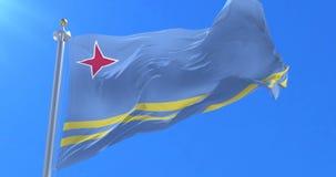 Bandera de Aruba que agita en el viento en lento con el cielo azul, lazo