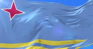 Bandera de Aruban que agita en el viento en lento con el cielo azul, lazo