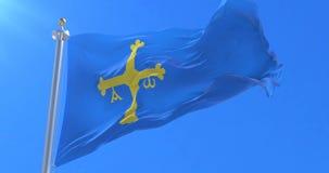 Bandera de Asturias que agita en el viento con el cielo azul, lazo