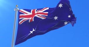 Bandera de Australia que agita en el viento en el cielo azul, lazo