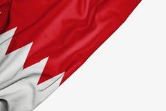 Bandera de Bahrein de la tela con el copyspace para su texto en el fondo blanco ilustración del vector