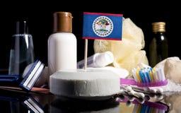 Bandera de Belice en el jabón con todos los productos para la gente Fotografía de archivo