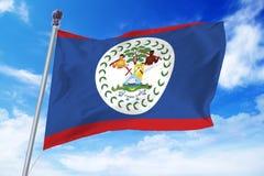 Bandera de Belice que se convierte contra un cielo azul claro Fotos de archivo libres de regalías