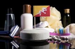 Bandera de Bhután en el jabón con todos los productos para la gente Fotos de archivo libres de regalías