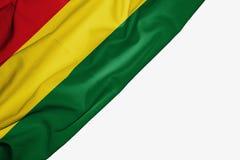 Bandera de Bolivia de la tela con el copyspace para su texto en el fondo blanco ilustración del vector
