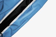 Bandera de Botswana de la tela con el copyspace para su texto en el fondo blanco stock de ilustración